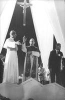 Pope Paul VI sending his blessings to people.