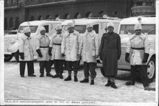 Three Red Cross ambulance wagons and some of their staff
