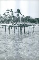 Dalida and a man throwing their cycles into water, 1963.