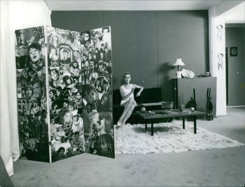 Vintage photo of Genevieve Grace sitting on couch in a room. Photo taken on Nov.15. 1967.