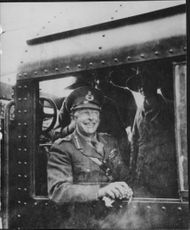 General Harold Alexander smiling while on the train.  - Jan 1943