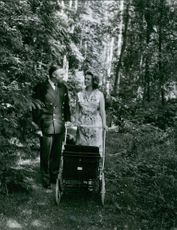 Princess Margaretha and John Ambler with pram.