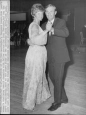 Margaret Court is dancing with John Newcombe under the traditional Wimbledon Ball