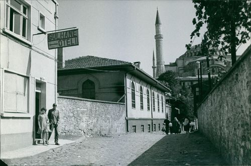 """A man and a woman stepping out of Gulhane Oteli """"Gulhane Hotel"""".  - 1966"""