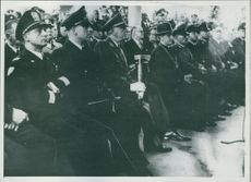 Officers gathered while siting together during Yugoslav Wars