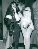 1969  Nicoletta and Annie Philippe talking to each other and smiling.