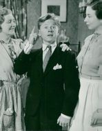 """Fay Holden, Mickey Rooney and Sara Haden in the movie """"Andy Hardy Gets Spring Feelings"""" - 22 February 1940"""
