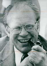 An informal portrait of President Gerald Ford, pipe in mouth and beaming broadly, taken by his daughter Susan Ford.