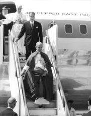 Pope Paul VI steeping down from airplane.