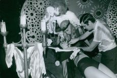 1970 Performers performing a horror show.