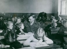 CHILD ARE IN A EXAM HALL