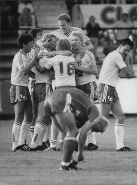 Happy Hammarby players hug over each other