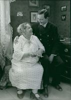 """Stina Berg and Håkan Westergren in a scene from the 1929 Swedish movie, """"Say it in the Toner""""."""