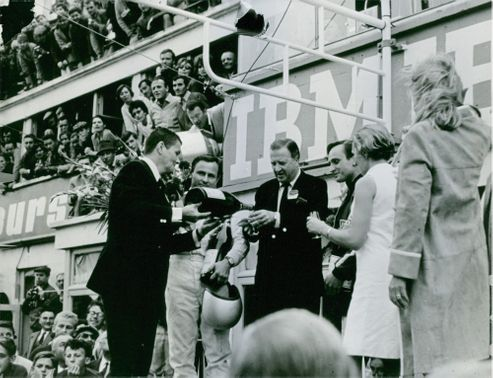 Henry Ford receiving drink on stage, 1966.