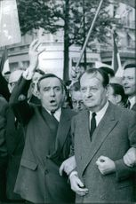 André Malraux with other people in a rally.