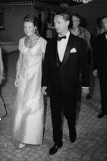 Princess Irene of the Netherlands with her husband Duke Carlos Hugo arriving at a party.