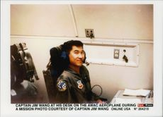 Captain Jim Wang at his desk boarded an AWAC aircraft during a mission