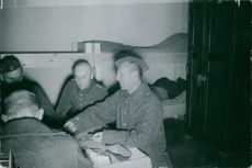 German soldiers playing cards in their barracks.  - Oct 1939