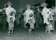 Women wearing Japan's traditional clothing while performing Moulin Rogue dance.  - Apr 1960
