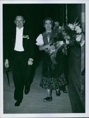 Einar Oscar Beyron and Brita Hertzberg walking together.