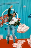 Sylvester Stallone assists in building a new Planet Hollywood restaurant
