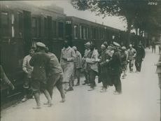 Soldiers standing on the railway station, boarding on the train during the first World war 1914-18  Sara bevelled I are heading to the German hospital
