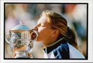 Steffi Graf kisses the winning cupboard at the French Open