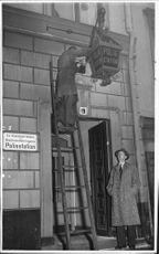 Inspector Herrlin view the 'new old' lantern outside Nicolai police station.
