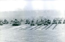 Soldiers of England Army with heavy armored vehicle and tanks.