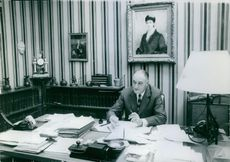 Pierre Marcilhacy sitting in his office.