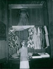 Preparing clothes for the wedding of Carl, Duke of Württemberg and Diane of France. 1960.