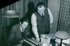 Officers in the office writing and searching documents about mine sweeping. 1939