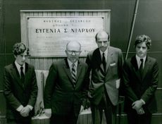 """Stavros Niarchos with his two sons Spyros Niarchos and Philip Niarchos, and a staff from the management of """"Niarchos Foundation"""", George Agouridis."""