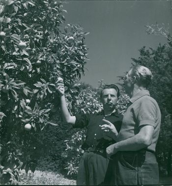 Paul Chevalier and Fred Freed in garden.