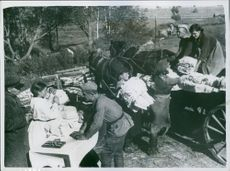Youth team of X bath and laundry unit send laundered and ironed underwear to men on the advanced lines. Photo taken in 1942.