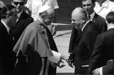 Pope Paul VI shaking hand with a man.