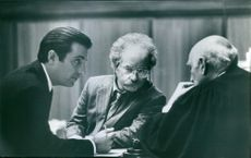Andy García and Richard Dreyfuss talking to another man during a scene of film Night Falls on Manhattan.