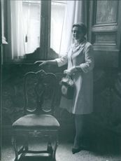 A photo of Elisabeth Soderstrom standing beside the window.