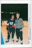 Actor Kiefer Sutherland and tennis player John McEnroe play ice hockey in favor of Christopher Reeve foundation