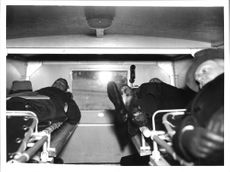 People on bunks in new constructed Finland ambulances from the Swedish Red Cross.