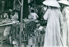 Vietnam Vietcongs buying canned goods in a store during wartime in Vietnam.