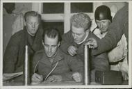 The Swedish volunteer corps signing a memorandum about the anti aircraft plan against Russians.