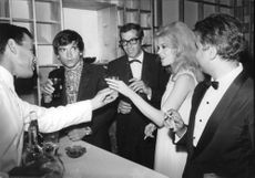 Roger Vadim talking to his friends.