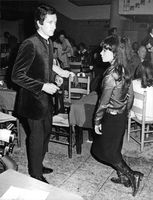 Pascale Petit with man in party.