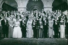 People stood together with the royals.