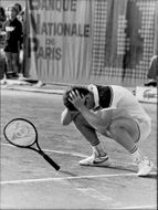 John McEnroe throws his racket after the loss in the final against Ivan Lendl in French Open 1984
