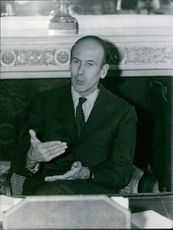 Giscard d'Estaing making hand gestures while talking.