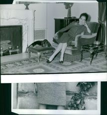 A woman siting in the couch.