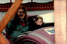 Sarah Ferguson and 7-year-old Princess Beatrice go for a carousel during their visit to Tivoli in London.