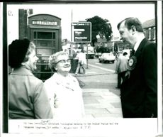Stanley Sorrell in Latchford Farrington talking to Mrs Galdys Taylor.